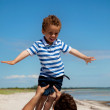 Kid Enjoying as His Dad Lifts Him — Stock Photo