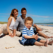 Mixed Race Family Looking Happy on the Beach — Stock Photo #13121197