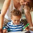 Preschool Teacher Looking at the Kid's Drawing — Stockfoto