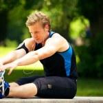 Athlete Doing Stretching Exercise — Stock Photo
