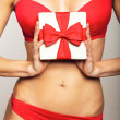 Woman in underwear holding gift — Stock Photo #14394591