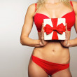 Woman in underwear holding christmas gift — Stock Photo