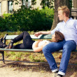 Romantic Couple Resting on the Park Bench — Stockfoto