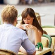 Dating Couple Together in a Parisian Street Cafe - Stock Photo