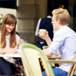 Young Couple Talking Over a Cup of Coffee — Stock Photo #16514007
