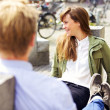 Woman Sitting on a Park Bench Together with Boyfriend - Foto de Stock
