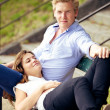 Sweet Guy with Girlfriend Resting on His Lap — Stock Photo #16514051