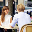 Stock Photo: Dating Couple in a Parisian Cafe