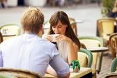 Dating Couple Together in a Parisian Street Cafe — Stok fotoğraf