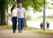 Couple in Love Strolling in a Park — Stock Photo
