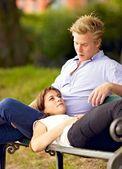Young Woman Lying on Her Boyfriend's Lap — Zdjęcie stockowe