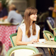 Beautiful Woman in an Outdoor Cafe - Stock Photo
