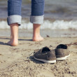 Man Leaving His Shoes Behind on the Sand — Stock Photo #16904973