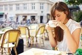 Woman Enjoying the Aroma of Her Coffee — Stock Photo
