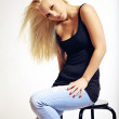 Young Woman in Jeans in a Seductive Pose — Stock Photo