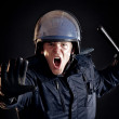 Angry Police Officer Telling Violent Crowd to Stop - Stock Photo