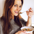 Cheerful Woman Holding a Bowl of Cereal — Stock Photo