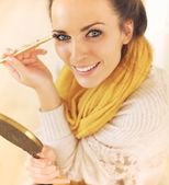 Confident Woman Putting Makeup On — Stock Photo
