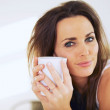 Attractive Woman Holding a Mug Close to Her Face — 图库照片