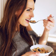 At Home with Smiling Woman Eating Breakfast — Foto Stock