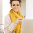 Confident Woman at Home Sitting — Stock Photo #22500885
