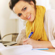 Cheerful Woman Writing in Her Journal — Stock Photo