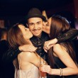 Guy Gets a Kiss from Attractive Party Girls — Stock Photo