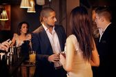 Young Businessman Hanging Out with Friends at the Bar — Stock Photo