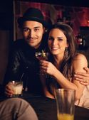 Attractive Couple Enjoying Their Drinks and Smiling at You — Stock Photo