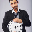 Stock Photo: Male Office Worker with a Wall Clock