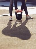 Kettlebell Being Lifted by Fitness Woman — Stock Photo
