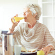 Stock Photo: Elderly WomDrinking Juice