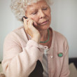 Grandmother Communicating Using a Cell Phone — Stock Photo #27201495