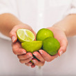 Holding a Handful of Sour Limes — Stock Photo