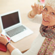 Old Woman in front of Her Laptop Looking at You — Stok fotoğraf