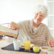Cheerful Grandma at Home Having Breakfast — Lizenzfreies Foto