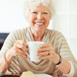 Smiling Senior Woman Having Her Breakfast — Stock Photo