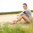 Happy Female Runner Resting — Stock Photo #29776961