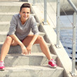 Tired Female Runner Sitting on the Stairs Resting — Stock Photo