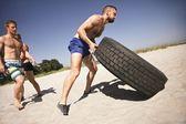 Tough crossfit workout on beach — Stock Photo