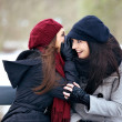 Stock Photo: Gossip Girls on Cold Winter Outdoors