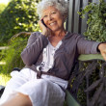 Happy senior woman talking on mobile phone — Stock Photo