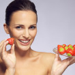 Gorgeous young woman with fresh strawberries — Stock Photo