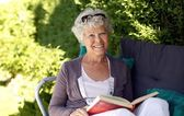 Elder woman reading a book — Stock Photo