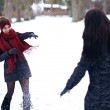 Playful Women Playing in the Snow Outdoors — Stock Photo