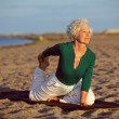 Yoga exercise on the beach — Foto Stock