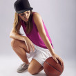 Female basketball player with ball — Stock Photo
