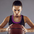 Portrait of female basketball player in studio — Stock Photo