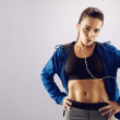 Female athlete relaxing after workout — Stock Photo