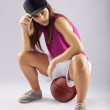 Beautiful and sporty female basketball player — Stock Photo